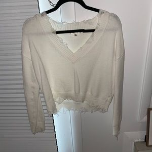 White v-neck distressed sweater